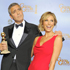 Actor George Clooney, left, poses backstage with the award for Best Actor in a Motion Picture Drama for the film 'The Descendants' with Stacy Keibler. Photo / AP