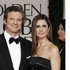 Colin Firth, left, and Livia Giuggioli arrive at the 2012 Golden Globe Awards. Photo / AP