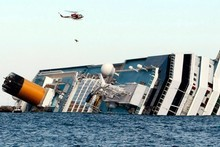 The luxury cruise ship Costa Concordia leans on its side after running aground off the tiny Tuscan island of Giglio, Italy.  Photo / AP