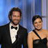 Presenters Gerard Butler, left, and Mila Kunis present an award at the 2012 Golden Globe Awards. Photo / AP