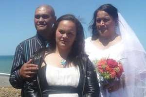 Mary-Lee Huata stands between her mother and her mother's new husband. Photo / Supplied