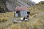 Philip Todhunter puts his feet up outside a classic backcountry hut on his mid-Canterbury