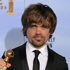 Actor Peter Dinklage poses backstage with the award for Best Supporting Actor in a Series, Mini Series or TV Movie for 'Game of Thrones'. Photo / AP