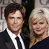 Rob Lowe, left, and Sheryl Lowe arrive at the 2012 Golden Globe Awards. Photo / AP