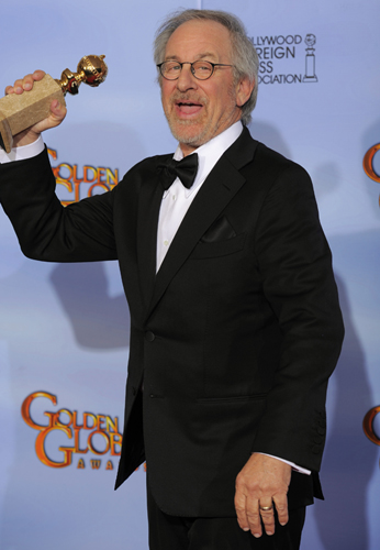 Director Steven Spielberg poses backstage with the award for Best Animated Feature Film for 'The Adventures of Tintin'. Photo / AP