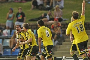 Emmanuel Muscat of the Phoenix celebrates with teammates after scoring. Photo / Getty Images