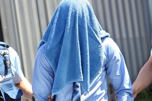 The 16-year-old is led from court yesterday after admitting that he sexually violated the little girl, a visitor to New Zealand, in a caravan in a Turangi campground. Photo / APN