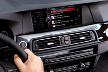 BMW's beefed-up iDrive and matching software has opened up a world of opportunities, including speech recognition to send texts and emails as you drive. Photo / Supplied