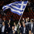 Greece's Alexandros Nikolaidis carries his national flag during the Opening Ceremony. Photo / AP