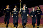 Torchbearers run during the Opening Ceremony at the 2012 Summer Olympics. Photo / AP