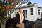 Juliet Blair in front of her Rautara St home in Orakei, Auckland, which sold at Auction for $846,000, $256,000 more that she paid for it a year earlier. 2 July 2012 New Zealand Herald Photograph by Ri