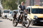 James Bond (Daniel Craig) ditches the Aston Martin for a Honda motorbike in the new 007 movie, Skyfall. Photo / Supplied