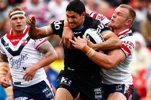 Brad Tighe of the Panthers is tackled by Martin Kennedy (2nd R) of the Roosters during the round 20 NRL match. Photo / Getty Images.
