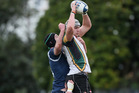 Jack Whetton secures the ball for Grammar Carlton. Photo / Getty Images