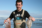 Leon Vaudrey is delighted with his snapper and gurnard caught off Muriwai Beach. Photo / Geoff Thomas