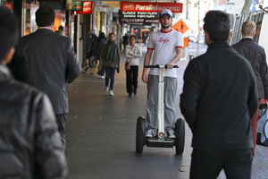 Artur Pelanda delivers pizza on a Segway. Photo / Michael Craig