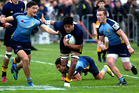 Akira Ioane (AGS) charges through MAGS players during their match last Saturday. Photo / Steven McNicholl
