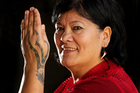 Doctoral student Mei Winitana, whose ta moko incorporates a puwerewere, or spider's web pattern, says some women are adding to their designs over time. Photo / Alan Gibson