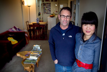 Brent Foster and Caroline Lim used Caroline's KiwiSaver subsidy to help to buy their apartment in Mt Eden. Photo / Natalie Slade