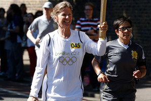 Barbara Kendall carries the Olympic Torch in Kew Gardens, London.  Photo / Mark Mitchell