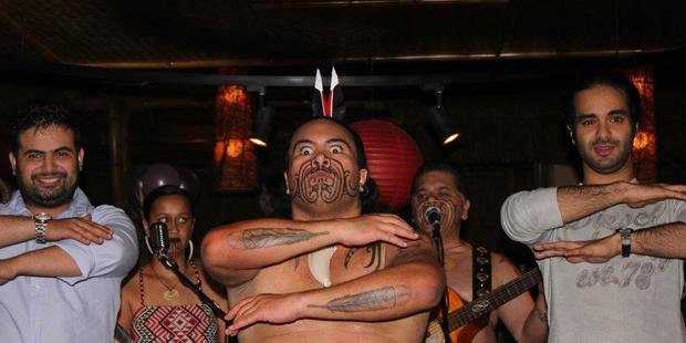 Hiwirori Maynard, centre, performs with Te Mana and a couple of visitors at the JW Marriott Hotel in Dubai. Photo / Supplied