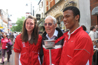Bill Plester's mate Don Crozier (centre) in Basingstoke with his granddaughter and Plester's torch. Photo / Steve Plester