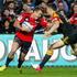 Israel Dagg fends off Sonny Bill Williams. Photo / Christine Cornege.