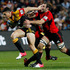 Sonny Bill Williams escapes the claws of George Whitelock. Photo / Christine Cornege.
