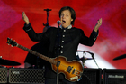 Sir Paul McCartney (or somebody who sounds a lot like him) has been heard as preparations for the Olympics opening ceremony continue, but will he be playing to empty seats? File photo / AP