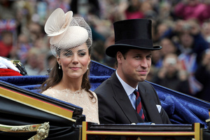 The Duke and Duchess of Cambridge pass along The Mall as part of a four-day Diamond Jubilee celebration. Photo / AP