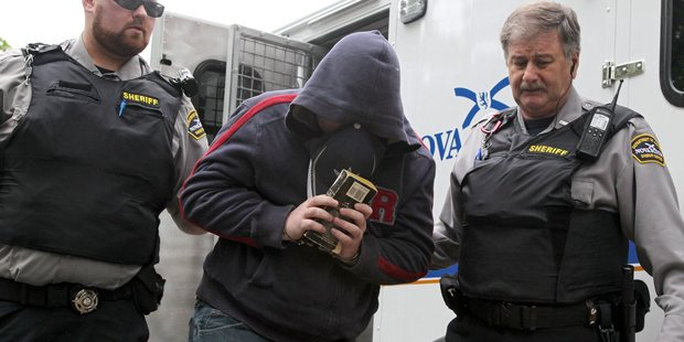 Loading Sub.-Lt. Jeffrey Delisle is escorted into Nova Scotia provincial court in Halifax on June 13, 2012. He's accused of selling state secrets - including NZ's - to Russia. Photo / AP