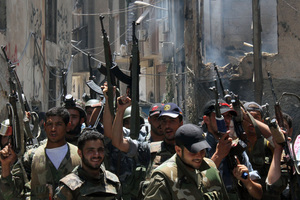 Syrian forces celebrate earlier after regaining control of Midan, in the southern part of Damascus. Photo / AP