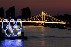 The Olympic rings floating on the Thames. Photo / AP.