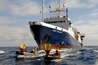 The survey vessel Orient Explorer bears down on Greenpeace inflatibles attempting to force the ship off course. Photo / Supplied