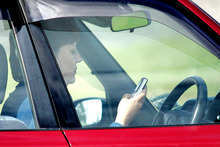 Drivers snapped using mobile phones. Photo / Doug Sherring