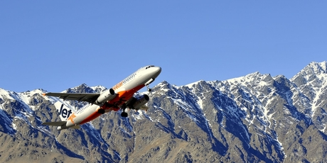 Jetstar A320 taking off from Queenstown airport. The airline says it will offer 120 domestic fares at $12 for every medal the Kiwi team wins. Photo / Supplied