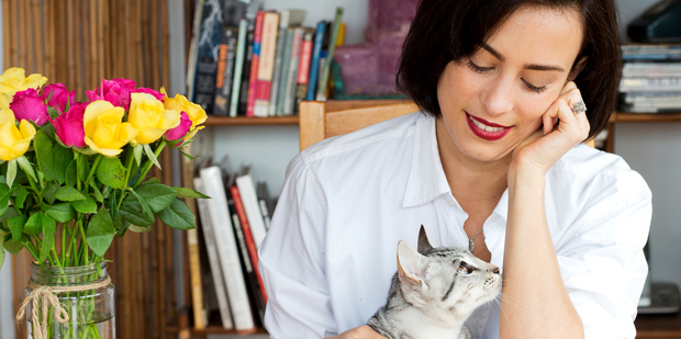 Art director and photographer Calypso Paoli at home with her cat Pepi Le Puss. Photo / Babiche Martens