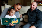 Marama, Teina, 3, and Paul Davidson are a family who choose to converse in te reo Maori in their Auckland home. Photo / Steven McNicholl