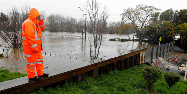 Loading Flood gates have been put up at the bridge into Paeroa as the Ohinemuri River rises. Photo / Christine Cornege