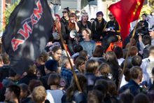Auckland University students block traffic at the intersection of Symonds St, Grafton Rd and Alfred St during a protest against changes to the student loans scheme. Photo / NZ Herald