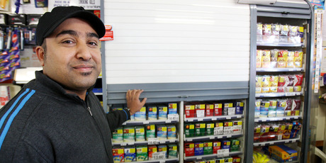 The new tobacco laws mean retailers such as Farrukh Khen at Lenz Superette in Cameron Rd, Tauranga, can't display cigarettes any more. Photo / APN