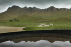 Te Mata peak is reflected in a wine barrel at Craggy Range winery. Photo / Hawkes Bay Today