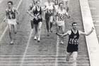 Peter Snell surges to a comfortable victory in the 1500m at Tokyo. Picture / Herald Files