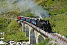A steam locomotive negotiates the Steinstafelviadukt on the picturesque Dampfbahn Furka-Bergstrecke in Switzerland. Photo / Creative Commons image by Wikimedia user David Gubler