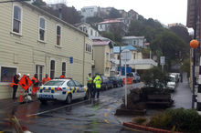 Police at the scene in Devon Street in Wellington, where a digger has rolled and killed a man. Photo / APNZ