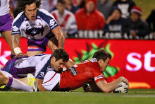 Brett Morris of the Dragons scores. Photo / Getty Images