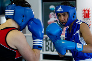 New Zealand amateur lightweight boxer Alexis Pritchard, in blue, ( along with Siona Fernandes ) will be the first female boxers to represent New Zealand at the Olympic Games. Photo / Brett Phibbs.