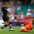 New Zealand Football Ferns player Sarah Gregorius in action against Great Britain's goalkeeper Karen Bardsley. Photo / Brett Phibbs