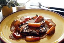 Pork chop with Cox's apple, sage and cream sauce. Photo / Doug Sherring