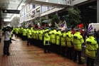 Police outnumber protesters at the end of the National Party conference at Auckland's Sky City convention Centre. Photo / Audrey Young